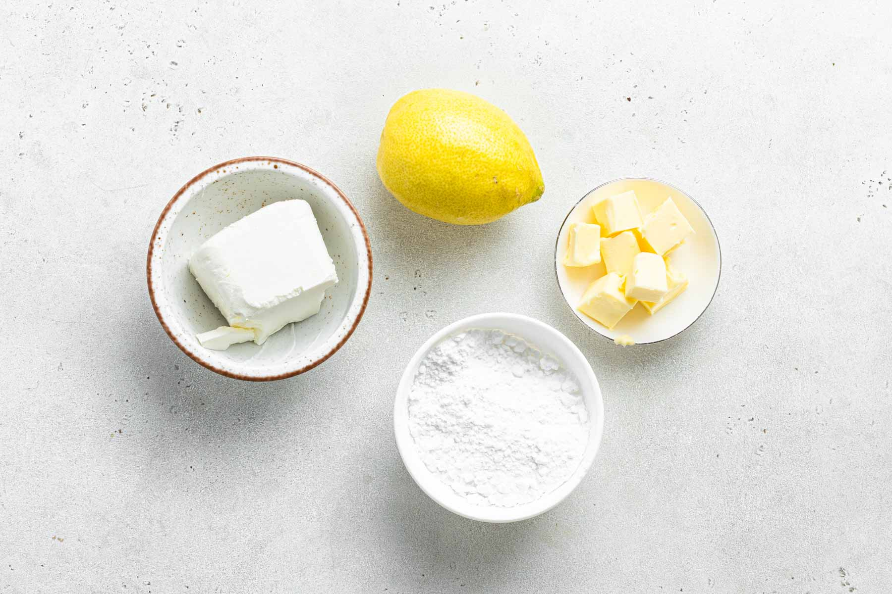 Ingredients for lemon cream cheese frosting.