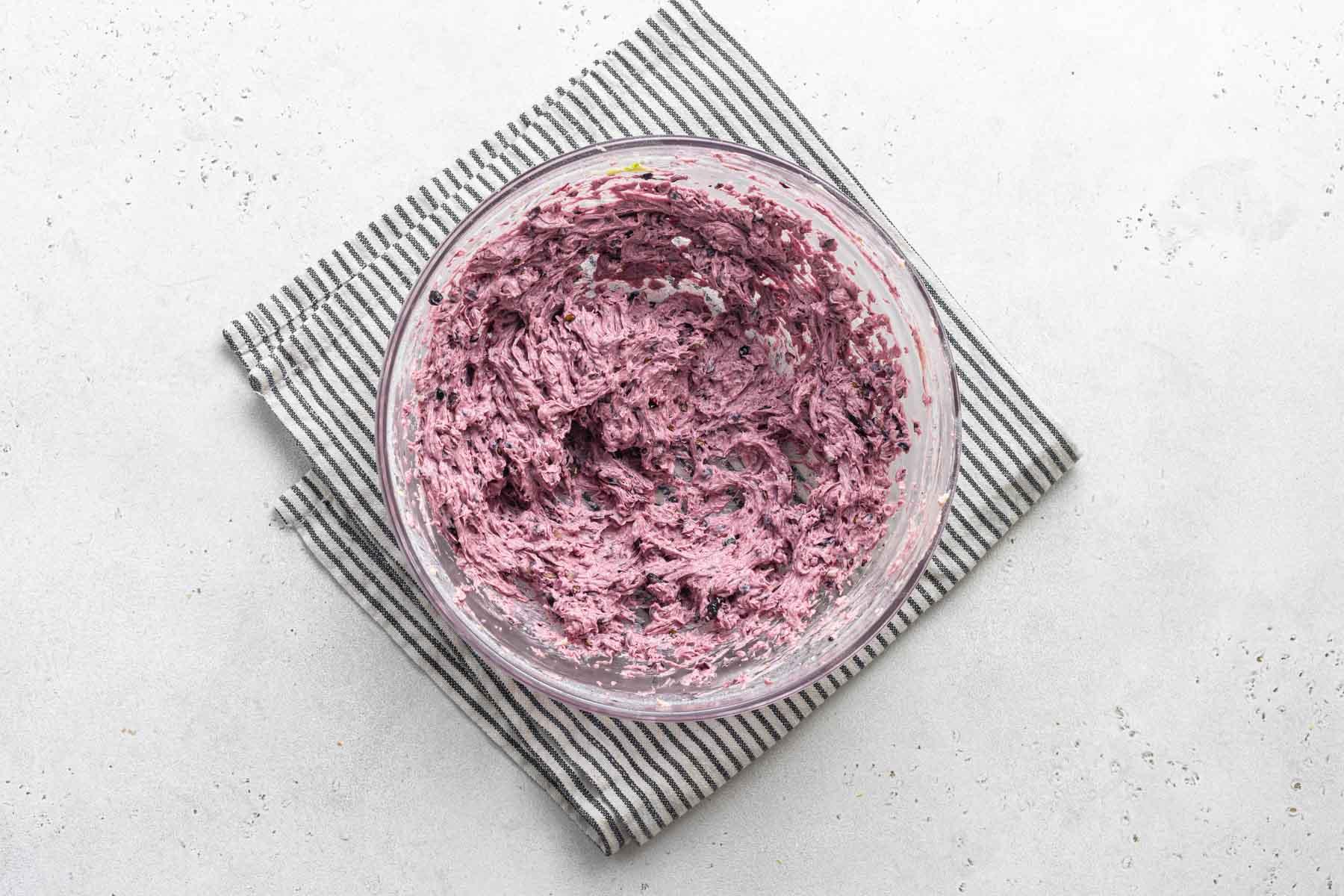 Purple fresh blackberry buttercream frosting.