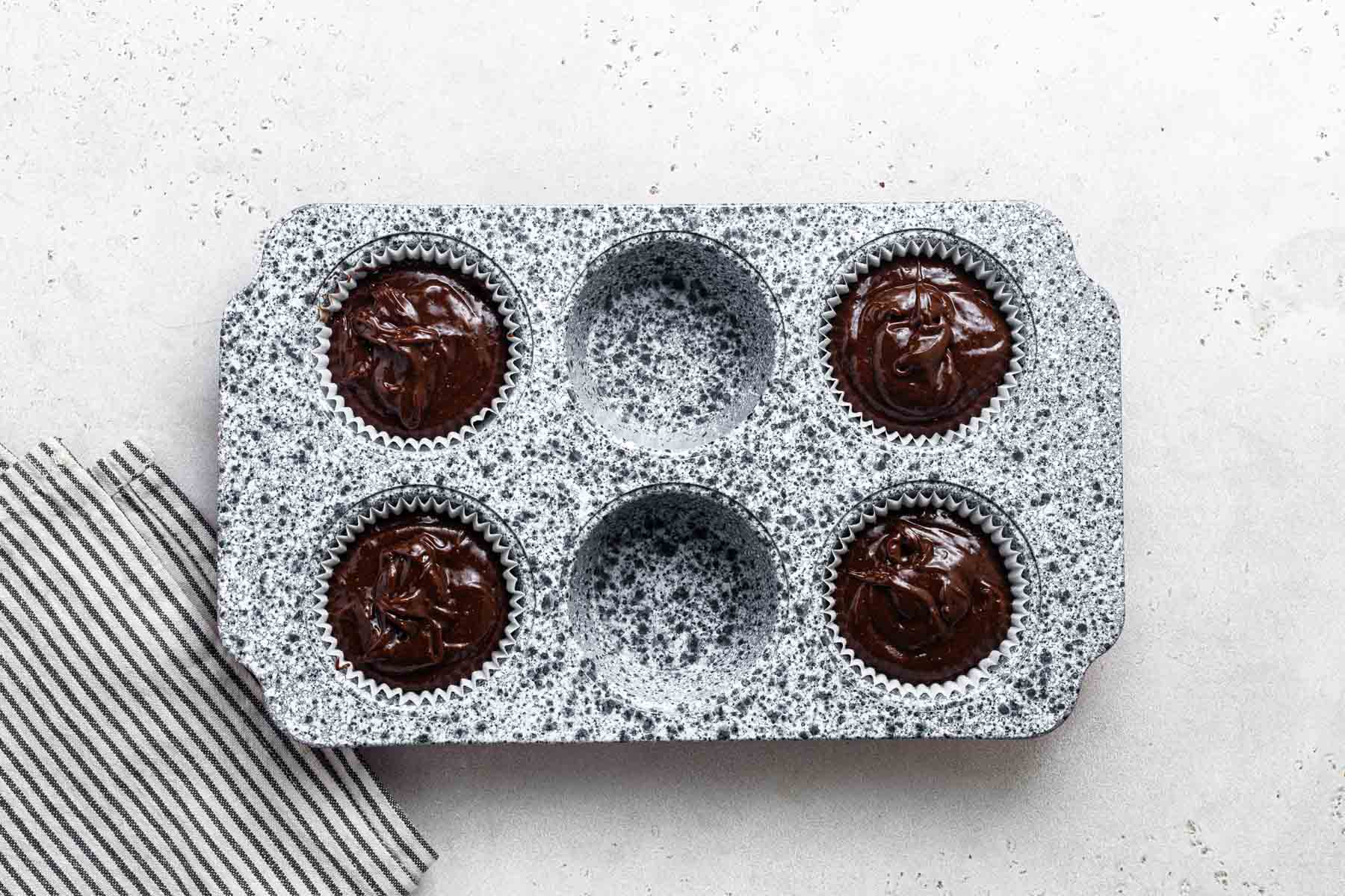 Small cupcake pan with 4 holes filled.