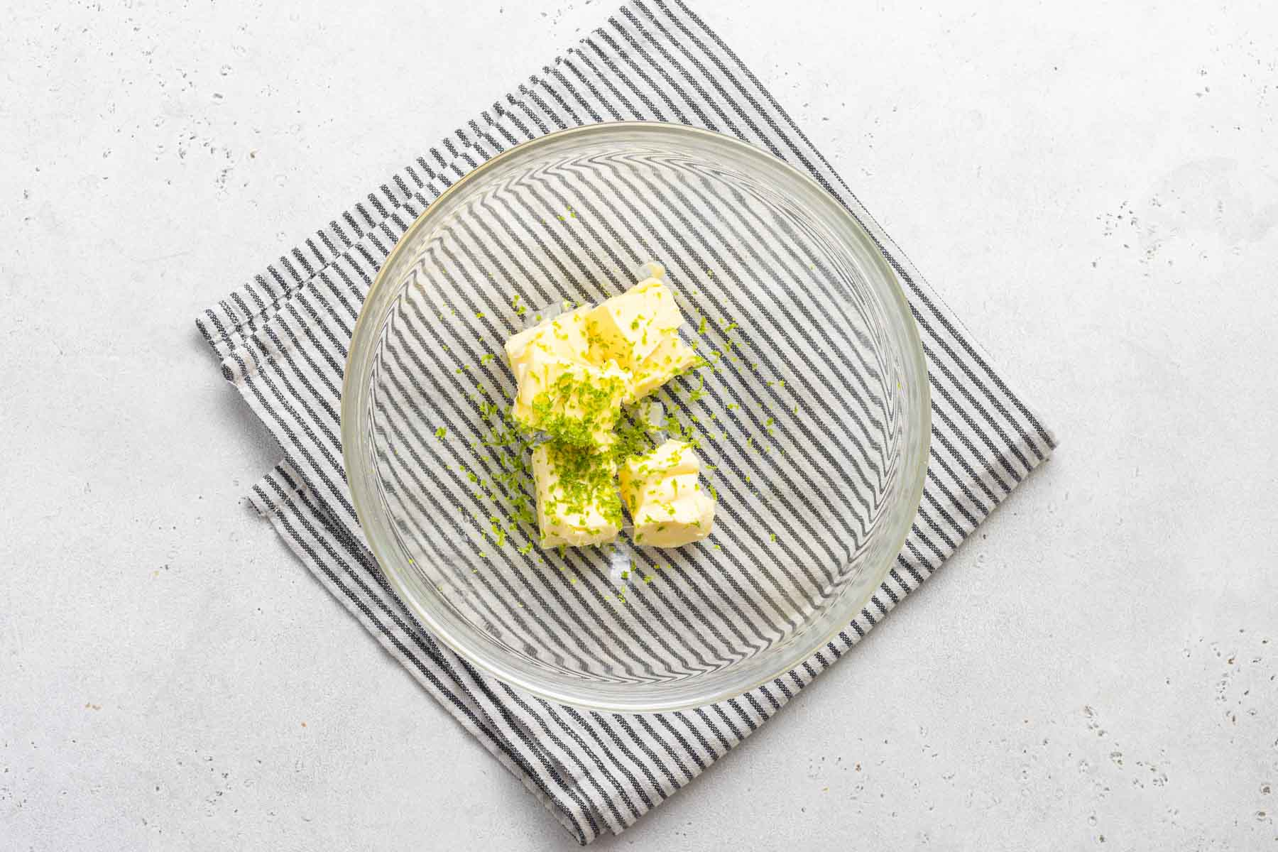 Lime and butter in clear bowl.