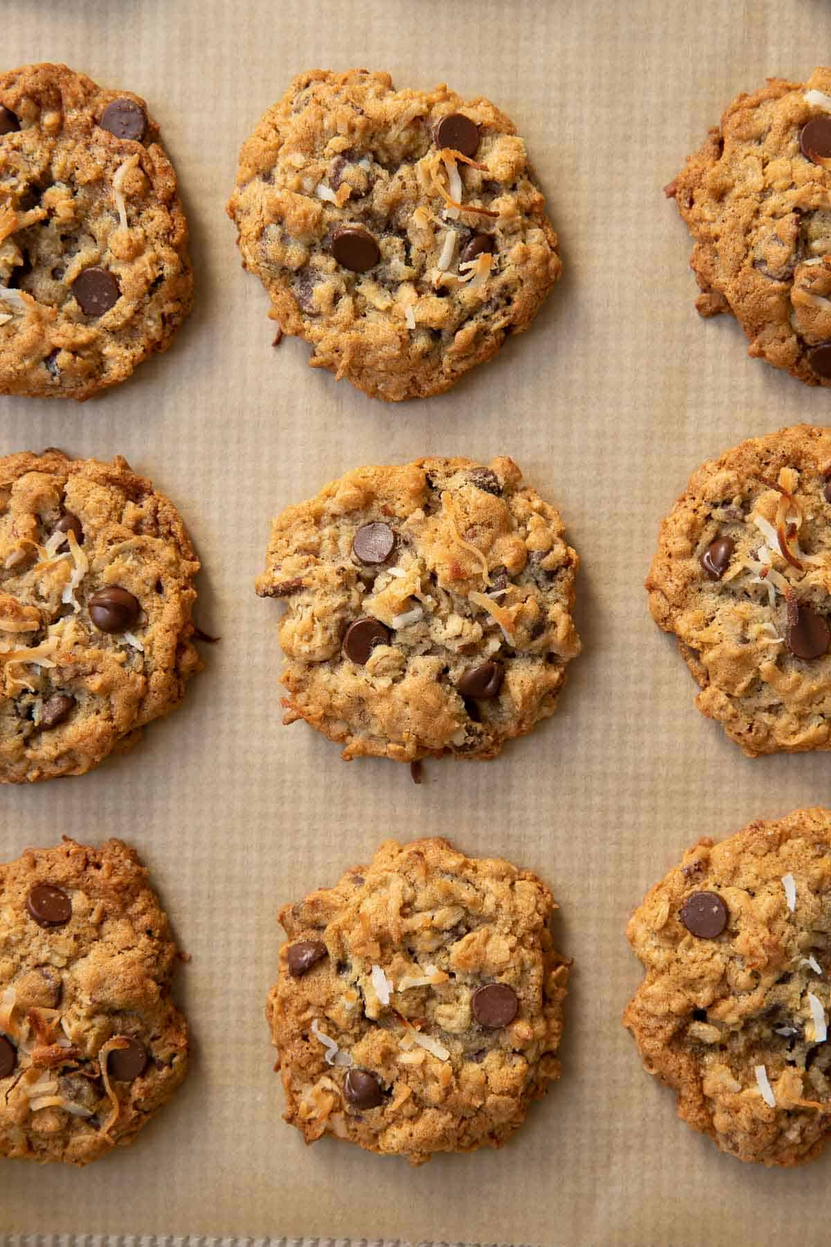 chocolate chip coconut cookies with pecans on a baking sheet