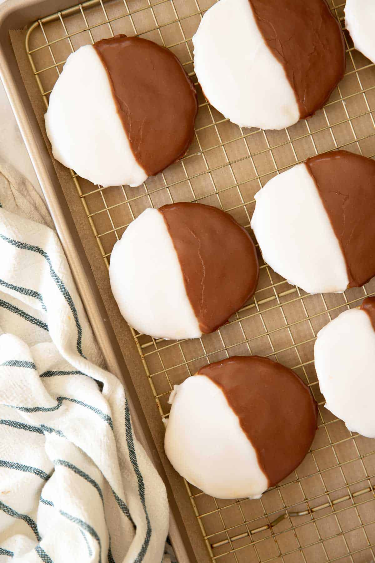 Black and white cookies on a baking sheet tray.