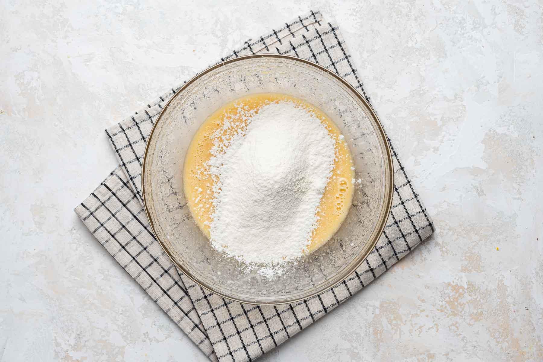 Flour on cupcake batter in bowl.