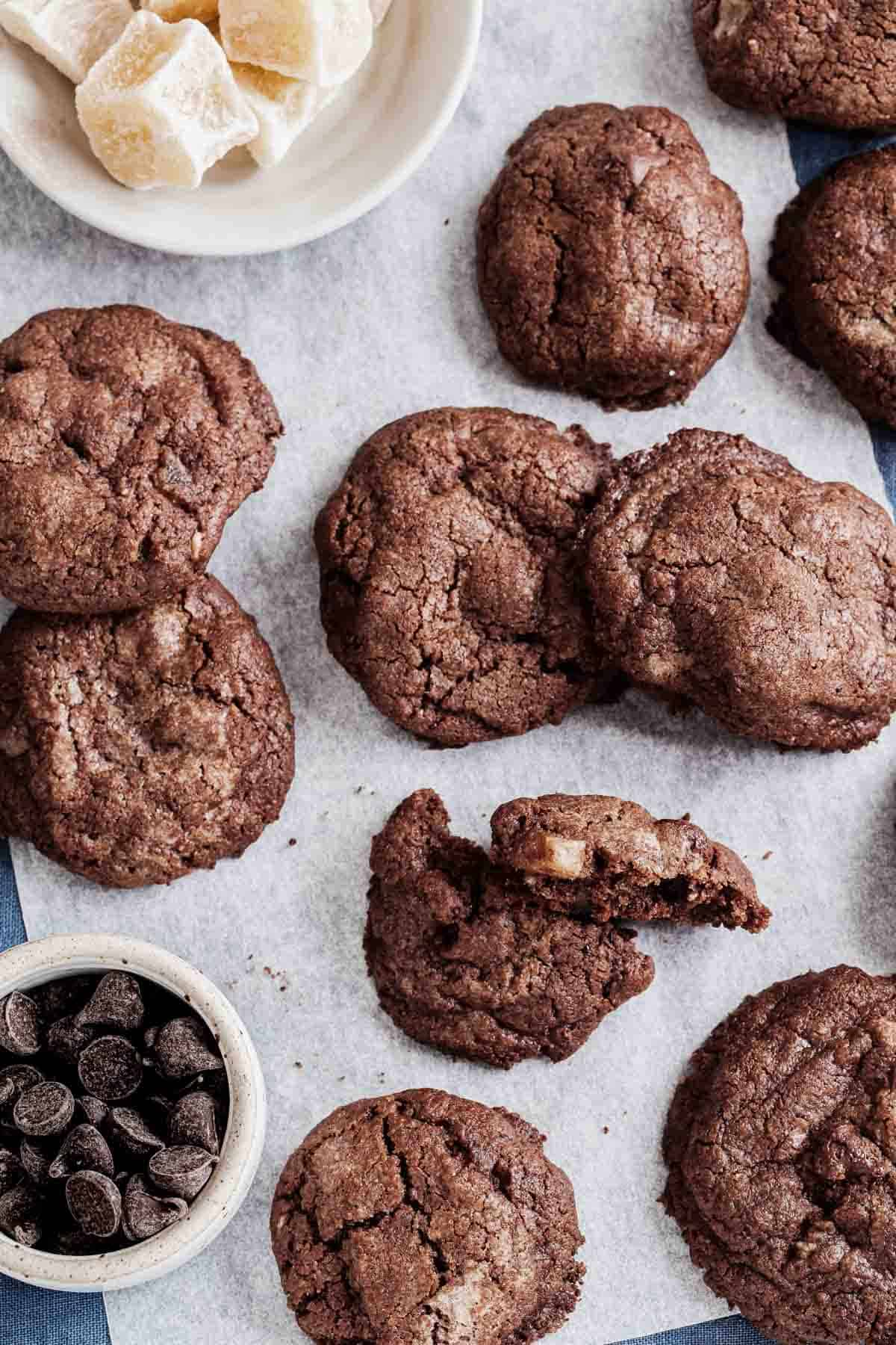 Chocolate ginger cookies on parchment paper.