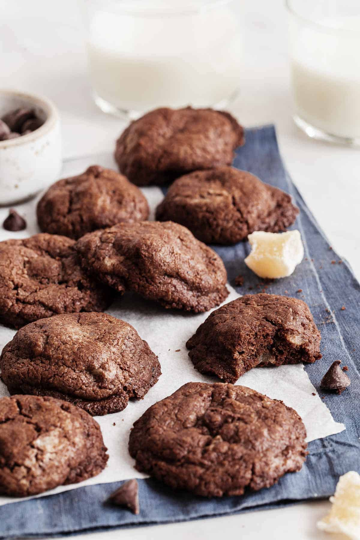 Stack of chewy chocolate cookies with ginger cubes.