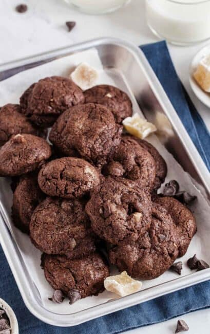 Chocolate ginger cookies on a silver tray.