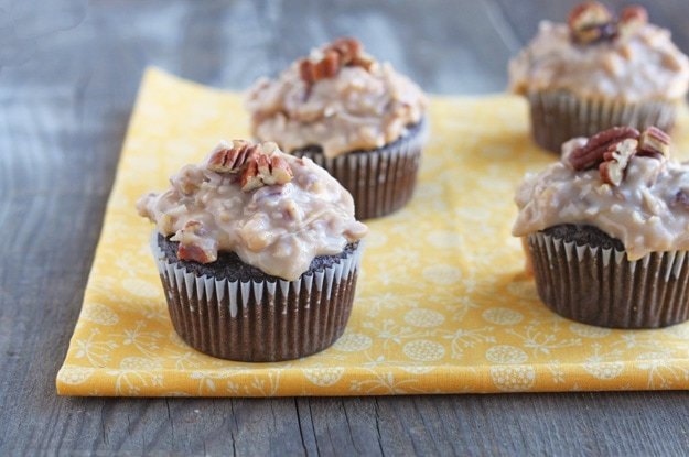 German chocolate cupcakes with creamy coconut frosting made with condensed milk! Small batch chocolate cupcake recipe with German chocolate frosting with coconut and pecans.