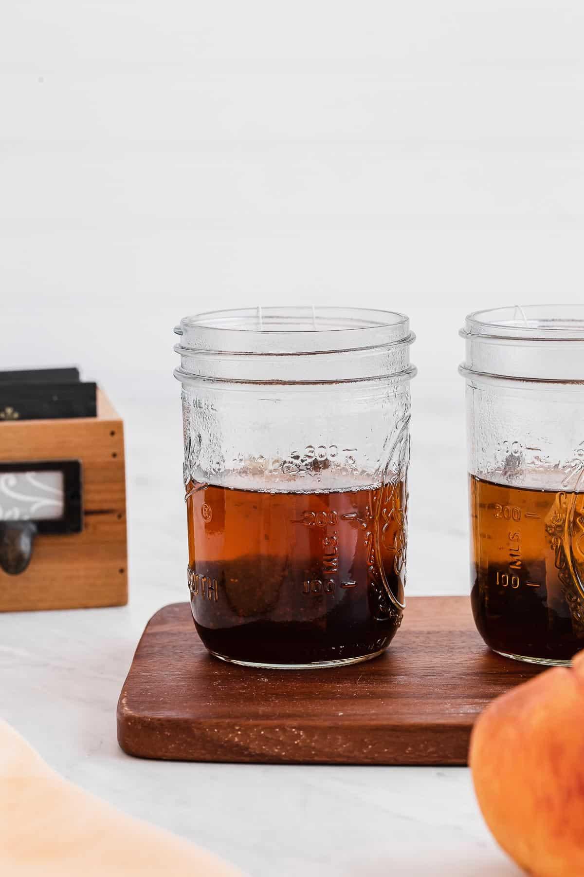 Black tea steeping in mason jars.