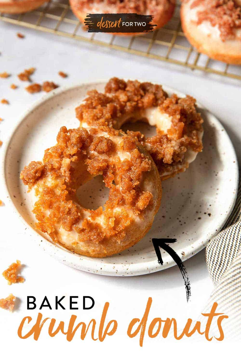 Two crumb donuts on a white plate.
