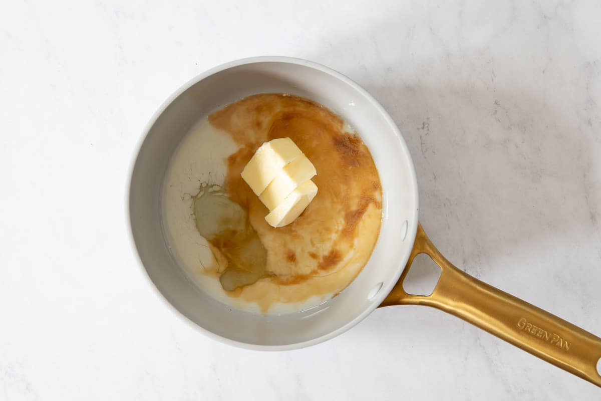 Small saucepan with butter, egg white, milk and vanilla.