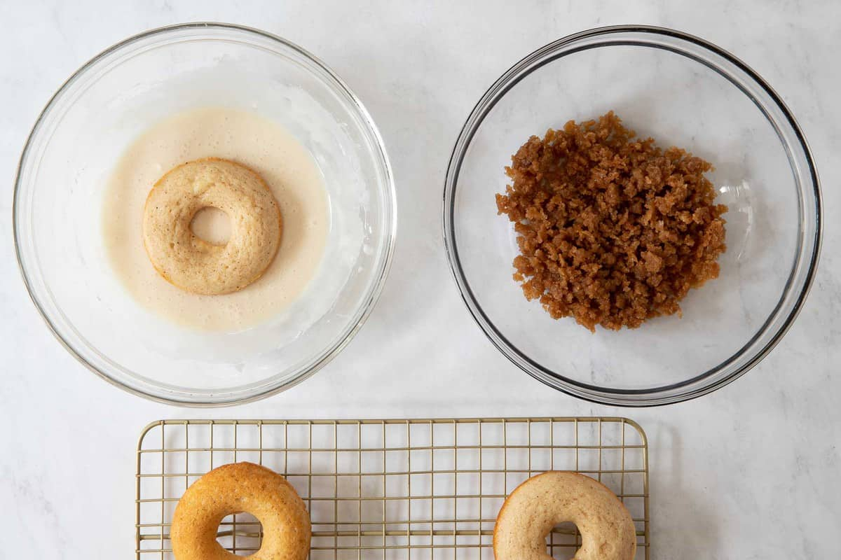 Bowls with donut glaze and crumb topping.