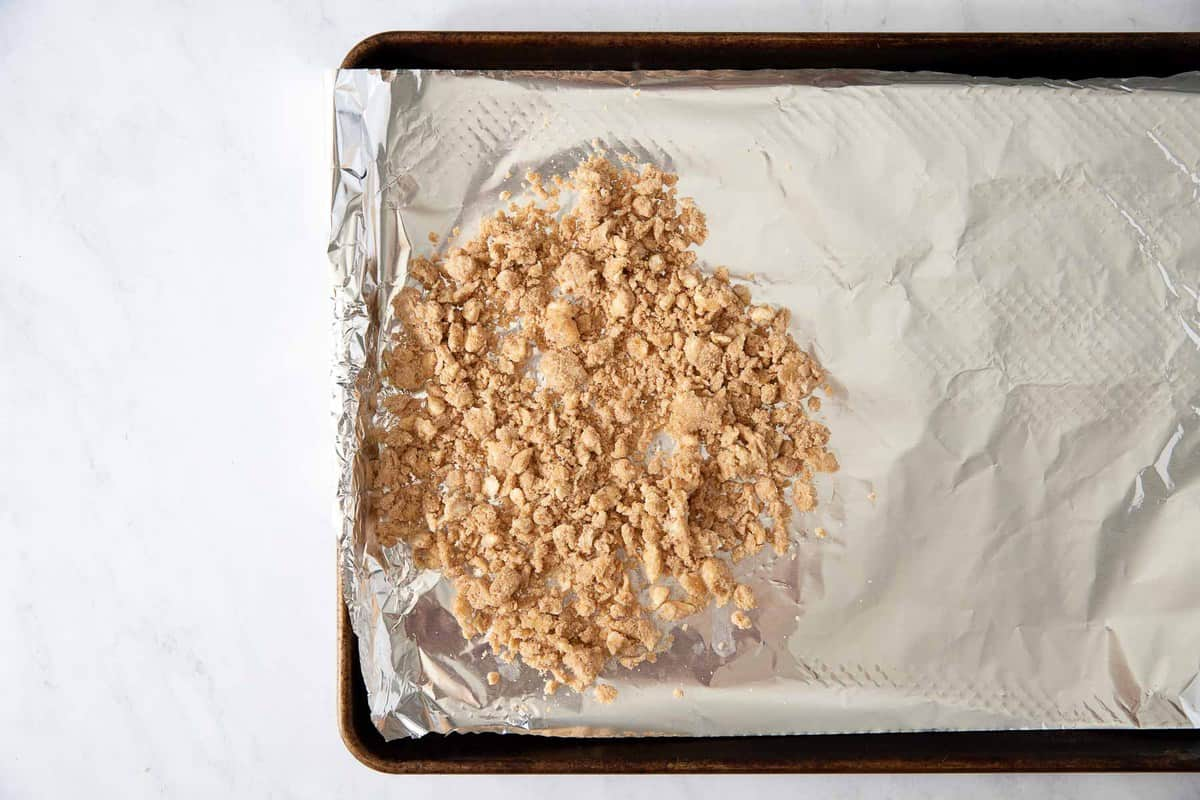 Raw crumb topping on a baking pan