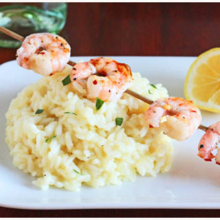 lemon risotto pile with grilled shrimp on top