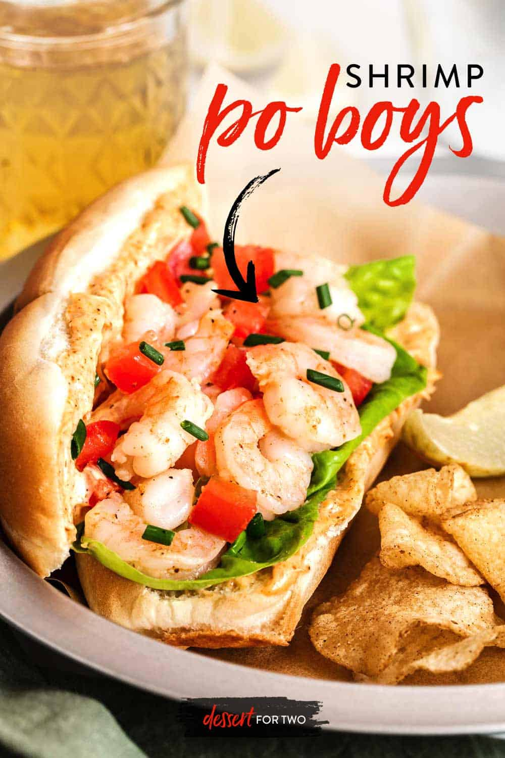 Close up of shrimp po boy sandwich with chips.
