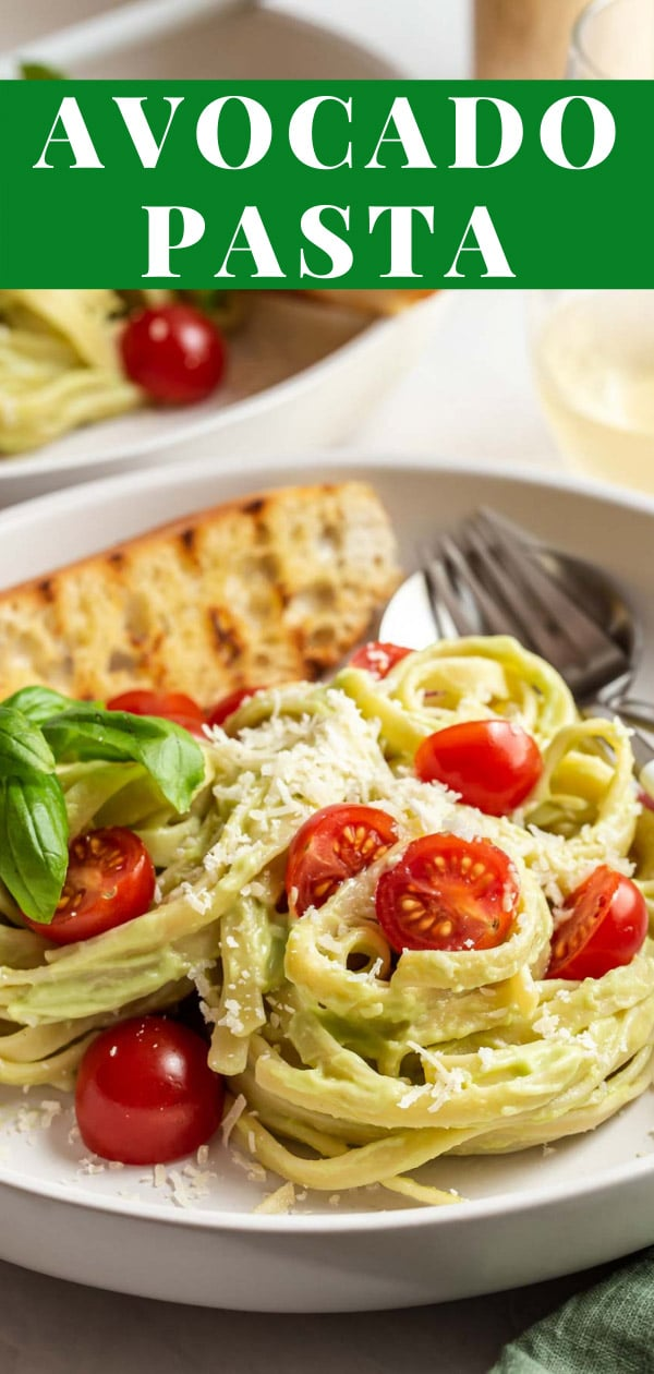 Close up of pasta on plate with fresh tomatoes.