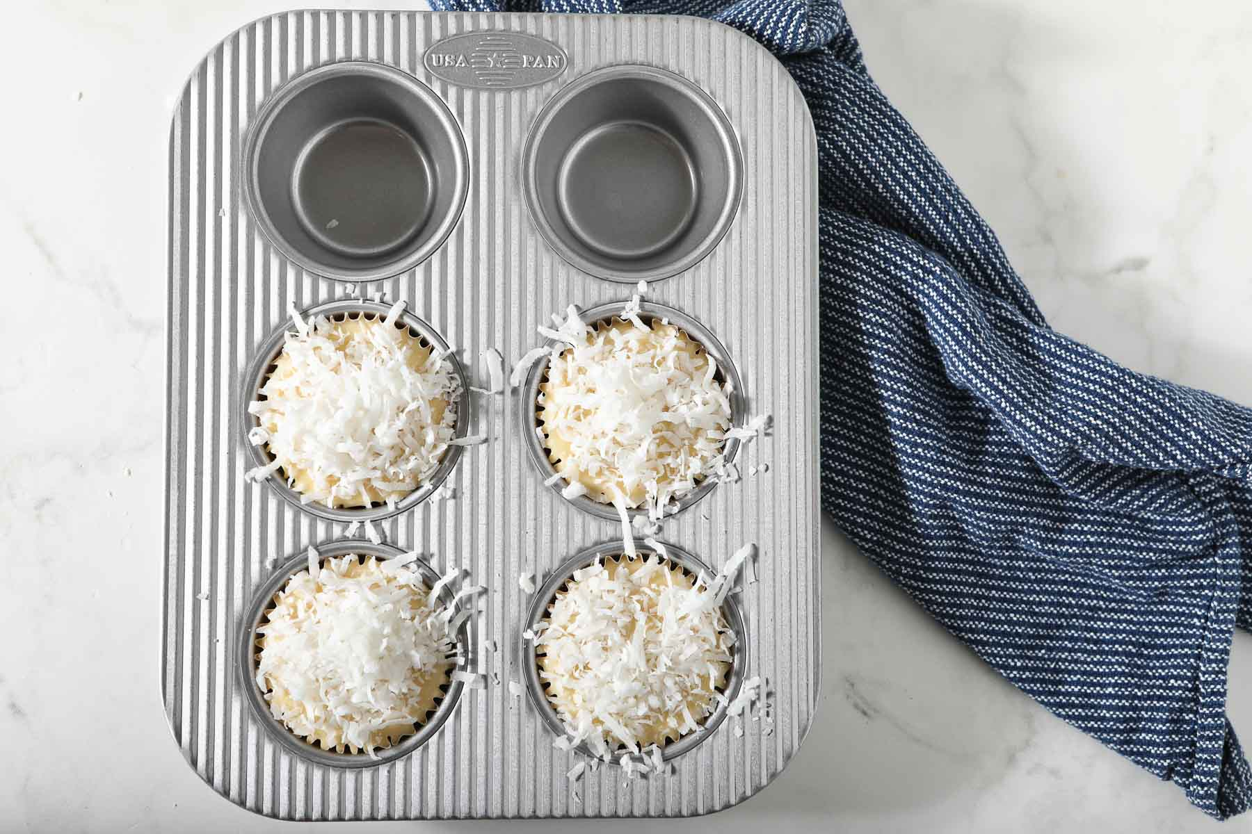 Shredded coconut on top of muffins, before baking.