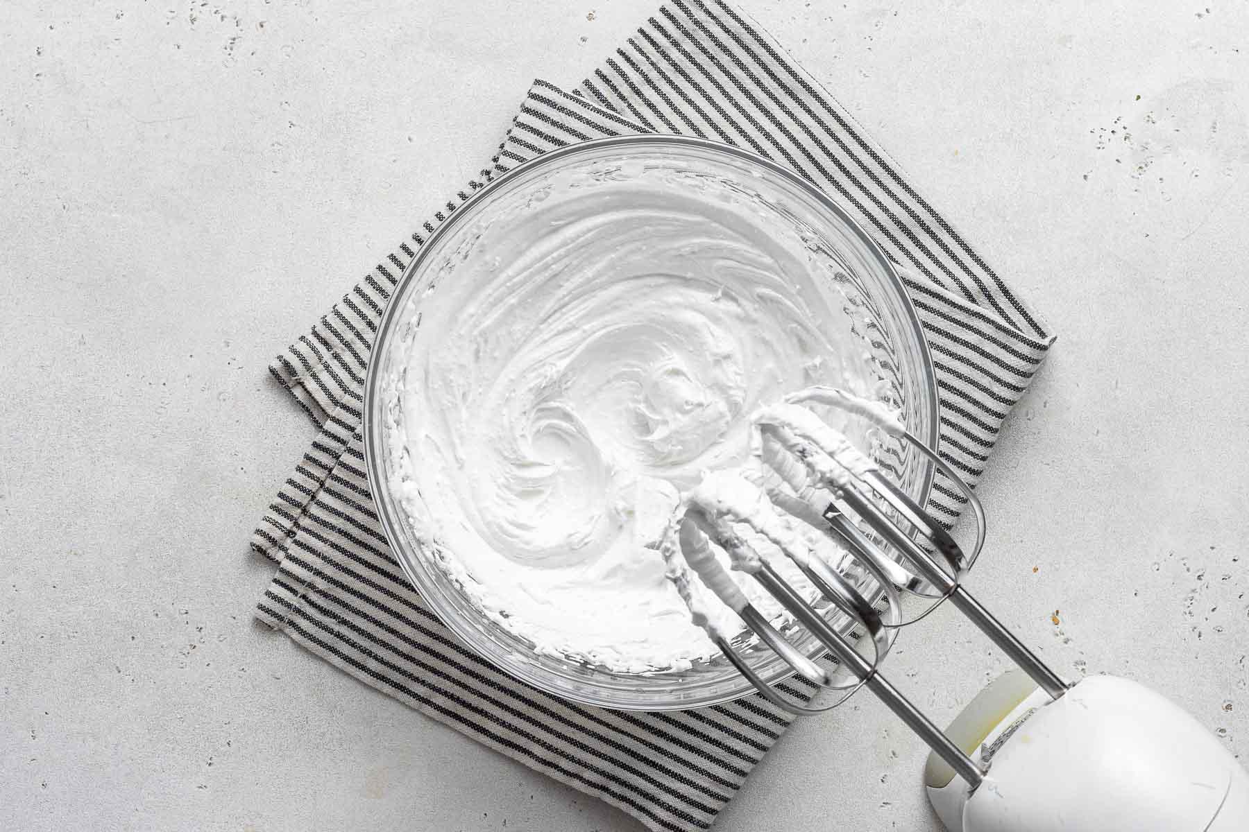 Properly beaten egg whites with stiff peaks.