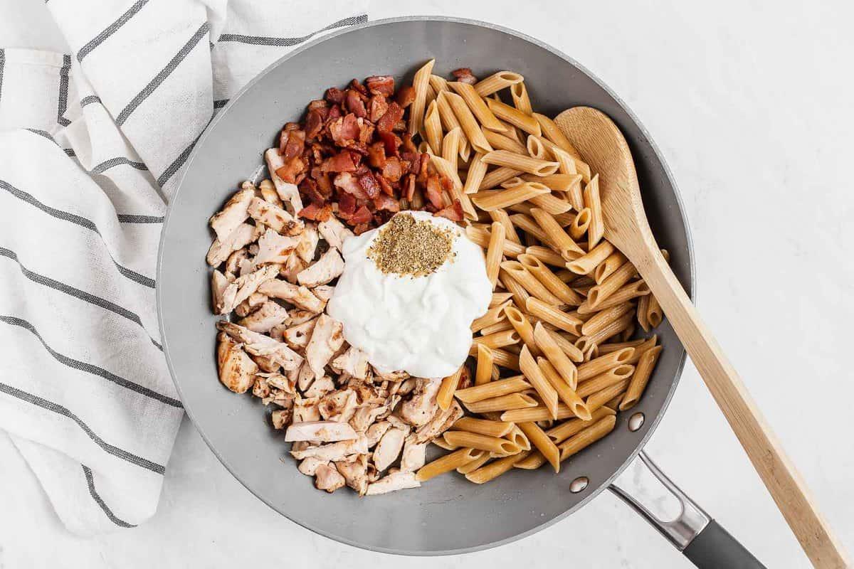 pan with chicken bacon pasta seasoning and yogurt