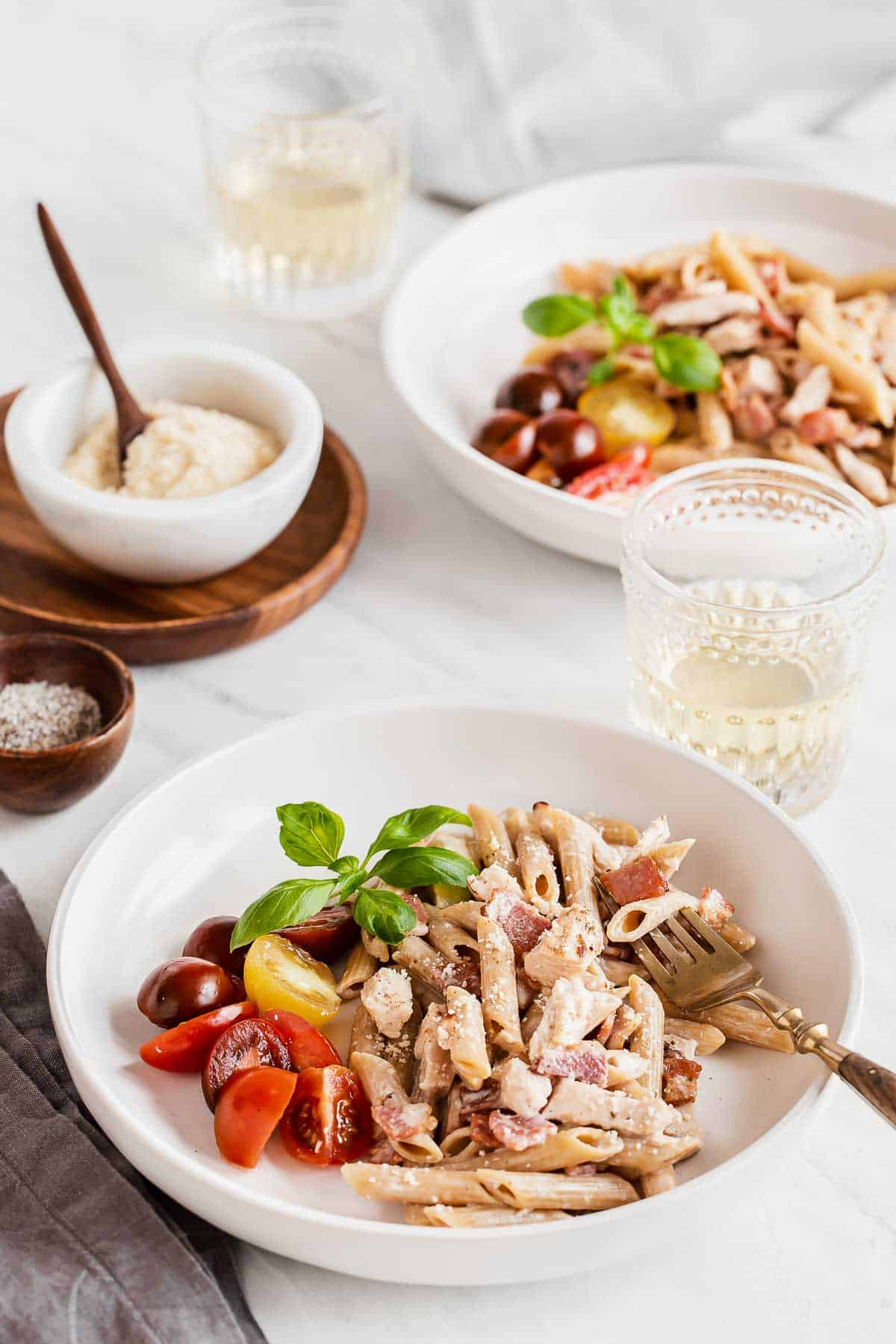 two bowls with chicken and creamy pasta