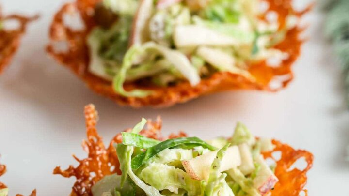 Brussels sprout slaw scooped into cheese cups.