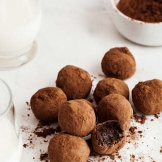 Pile of healthy chocolate truffles with bite missing from one.