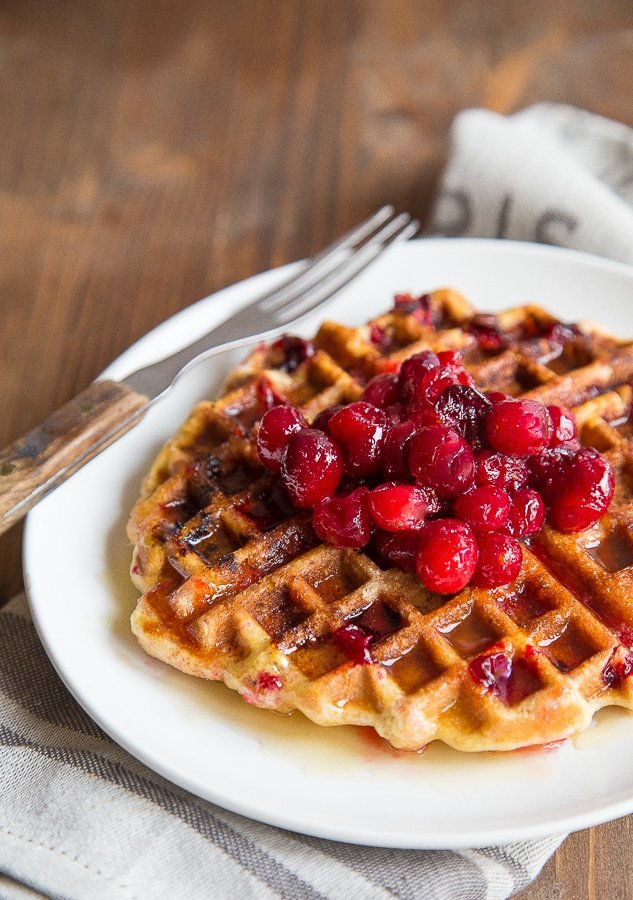 Use that leftover cranberry sauce in these cornmeal waffles. Bonus cider syrup recipe, too! @dessertfortwo