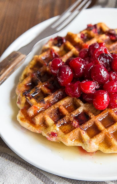 Cranberry Cornmeal Waffles: Use that leftover cranberry sauce in these cornmeal waffles. Bonus cider syrup recipe, too! @dessertfortwo