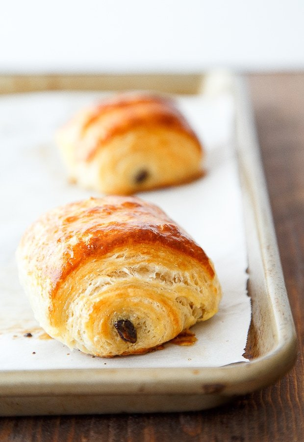 Homemade chocolate croissants with step by step guide.