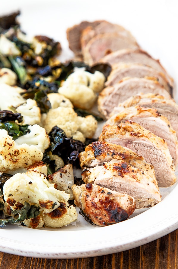 Easy pork tenderloin baked with roasted vegetables