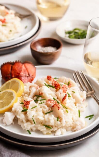 Lobster risotto on plate with lobster tail.