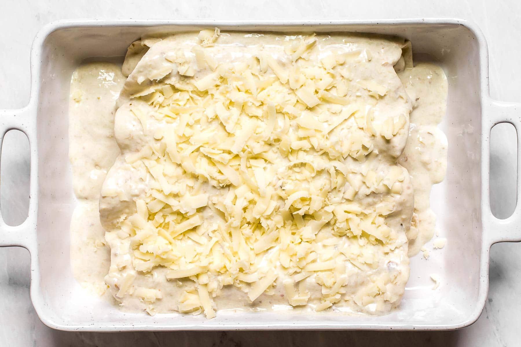 Creamy enchiladas before baking.