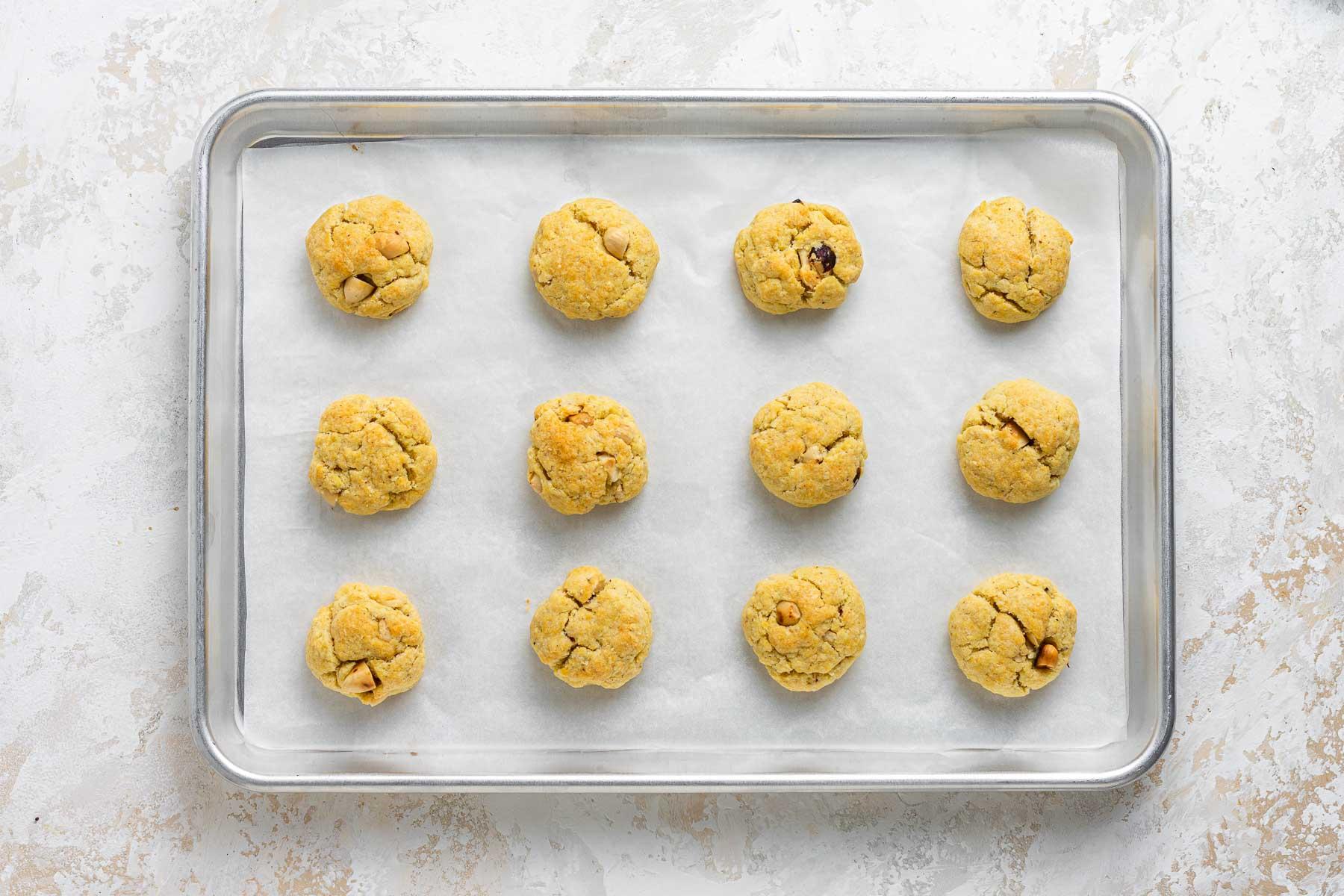 Baked hazelnut cookies on sheet pan.