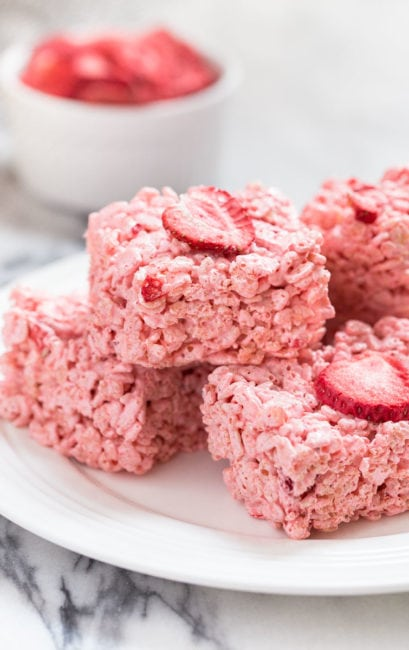 Strawberry Rice Crispy Treats made with Strawberry Fluff and freezer dried strawberries.