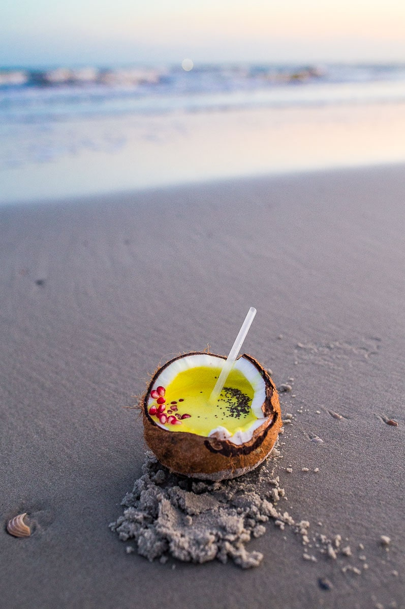 Recipe for a healthy turmeric coconut smoothie in a fresh coconut
