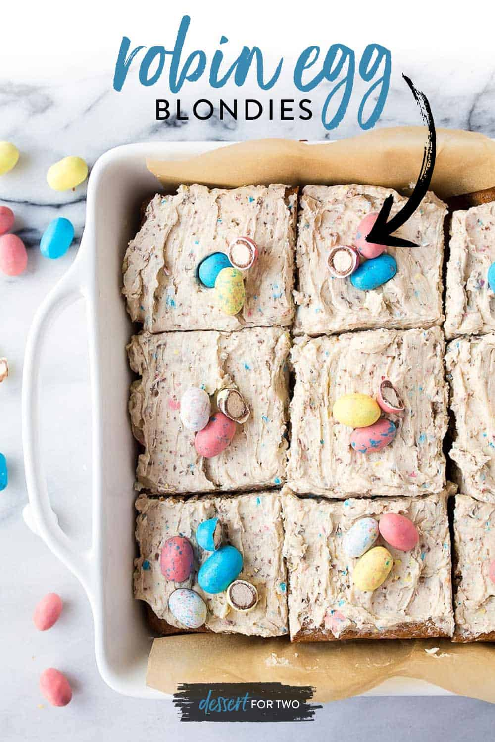 Square dish of frosted blondies with robin eggs on top.