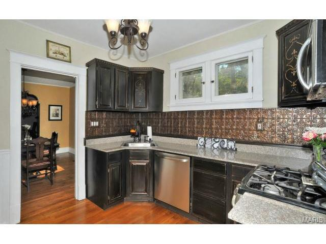 Kitchen Update: paint cabinets white, change backsplash, keep counters.