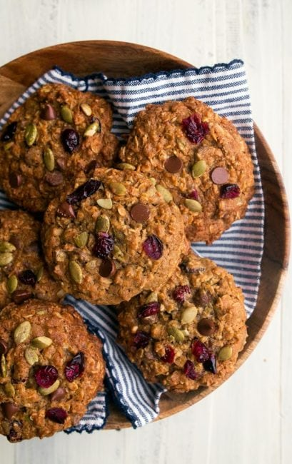 Pumpkin Spice Oatmeal Cookies with cranberries, pepitas (pumpkin seeds), and coconut. Big, chunky chewy cookies.