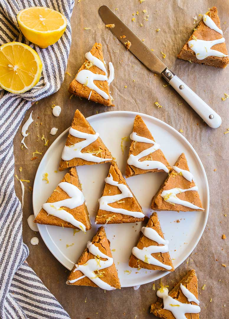 Gingerbread Blondies with Lemon Glaze cut into triangles to make Christmas trees.