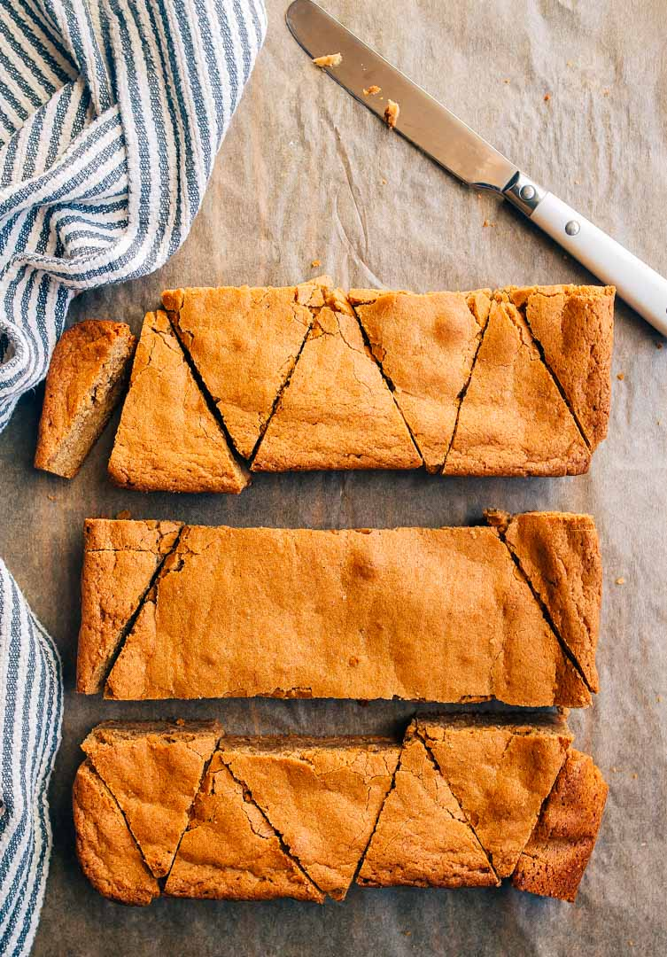 Gingerbread Blondies with Lemon Glaze cut into triangles to make Christmas trees. How to cut brownies into triangles to make Christmas trees.