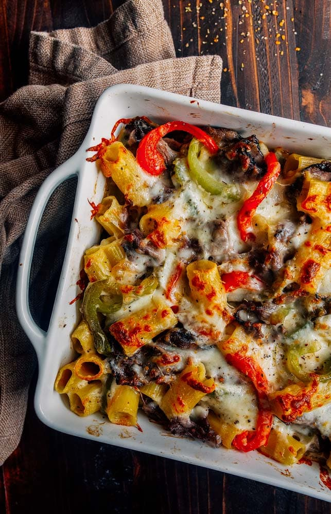 Philly Cheesesteak Pasta. Creamy baked pasta with peppers, onions, and steak.