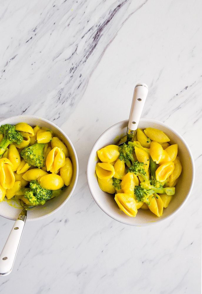 Healthy Mac and Cheese with turmeric, broccoli, and nutritional yeast. Perfect healthier version of macaroni and cheese for toddlers.