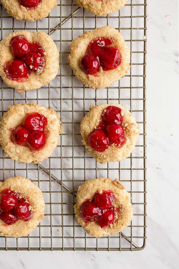 Cherry Cheesecake Cookies: cheesecake cookies rolled in graham cracker crumbs and topped with canned pie cherries.