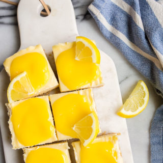 Lemon Cheesecake Bars with Homemade Lemon Curd. Cheesecake lemon bars are a fun, easy summer dessert.