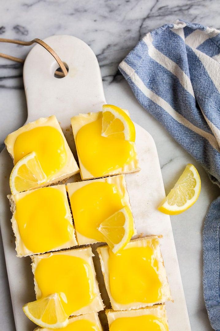 Lemon Cheesecake Bars with Homemade Lemon Curd. Cheesecake lemon bars are a fun, easy summer dessert.