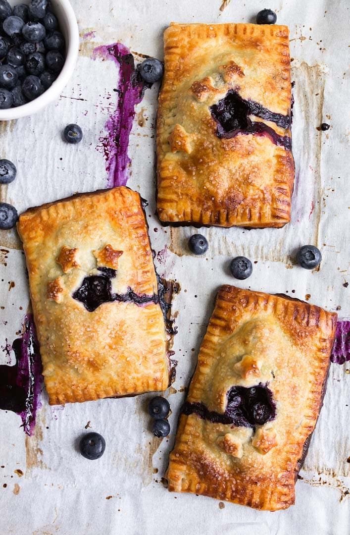 Blueberry Hand Pies Recipe: a mini blueberry pie you can hold in your hand. The best hand pie recipe.