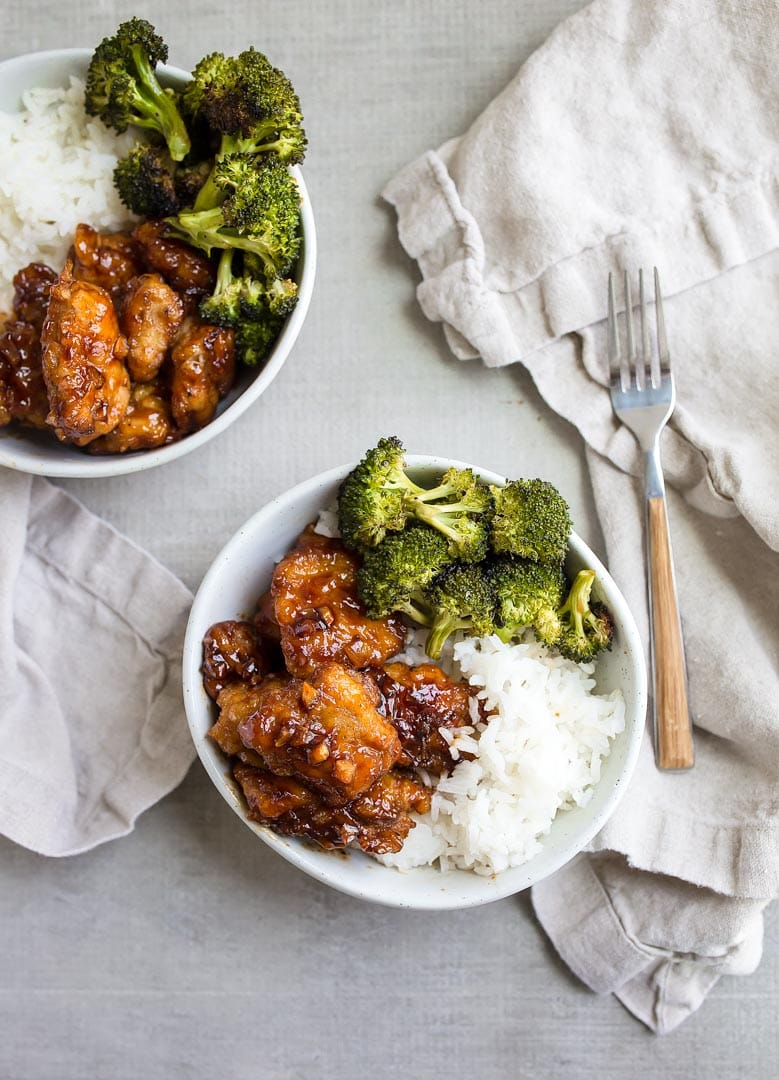 honey garlic chicken thighs recipe with roasted broccoli on the sheet pan