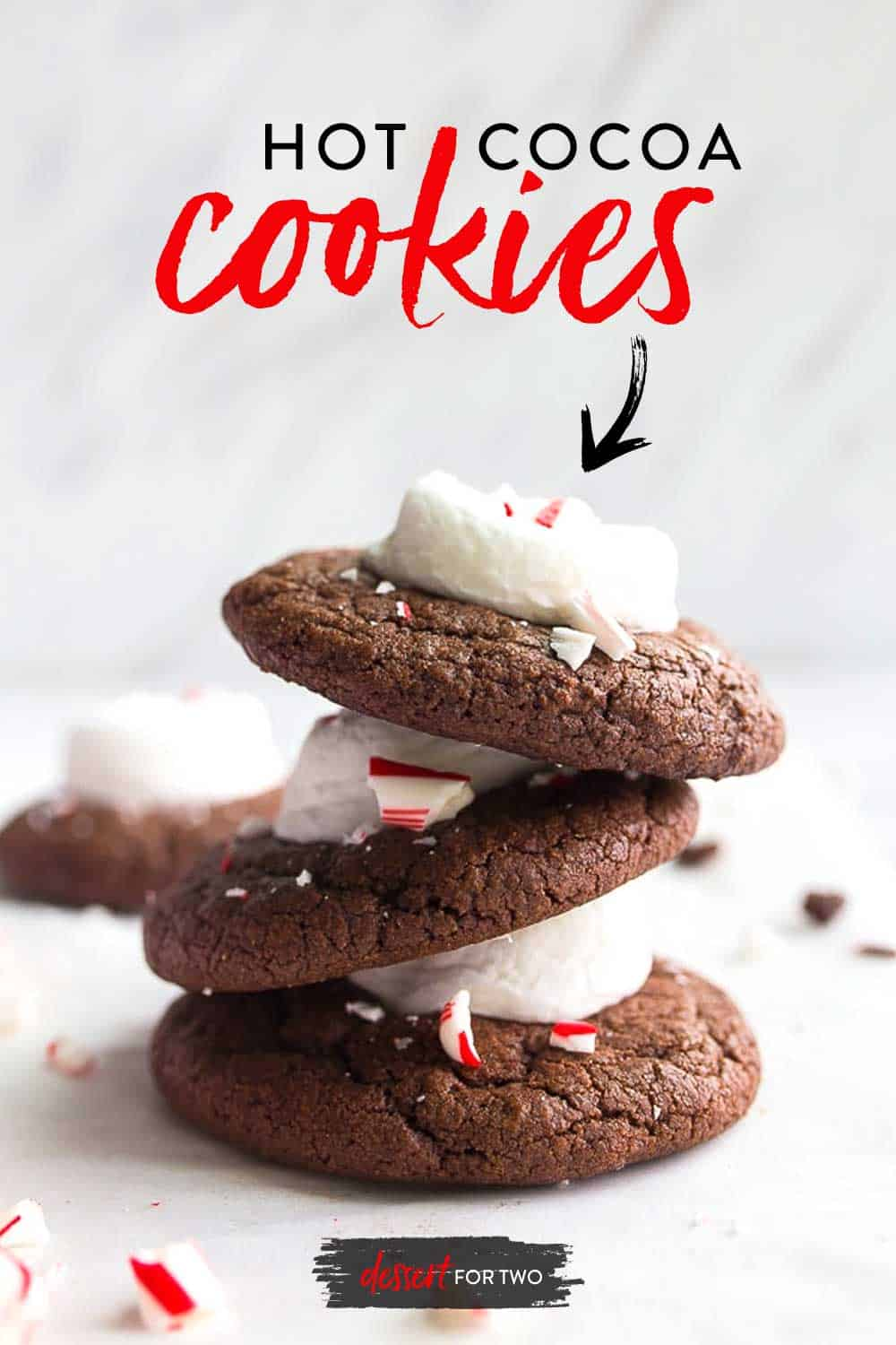 Hot cocoa cookies with marshmallows and candy canes. One dozen hot chocolate cookies topped with melted marshmallows and crushed peppermints. #christmascookies #hotcocoacookies #hotcocoa #hotchocolate #hotchocolatecookies #marshmallow #candycane #peppermint #chocolatepeppermint #cookiesforSanta