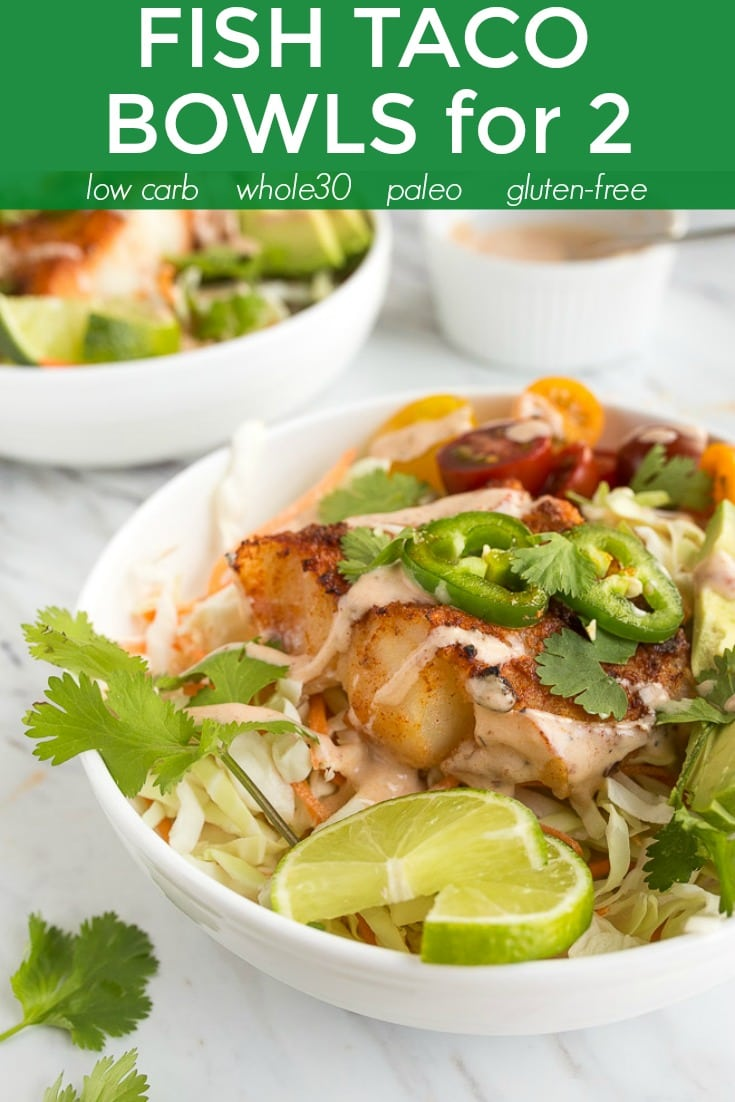 Fish Taco Bowls for two. Low carb, whole30 compliant, paleo and completely gluten-free! Smoky chipotle baked cod with creamy coleslaw and veggies on top. You won't miss the chips! #whole30 #fishtacobowls #fishtacos #chipotle #paleo #lowcarb #glutenfree