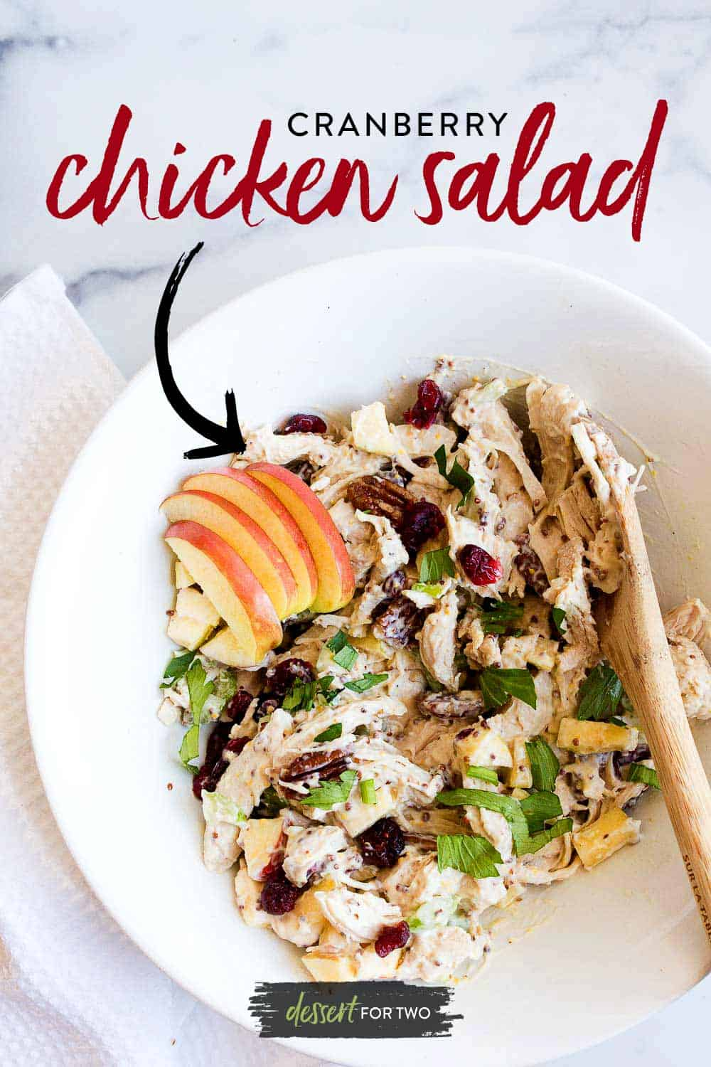 bowl of cranberry chicken salad with sliced apples