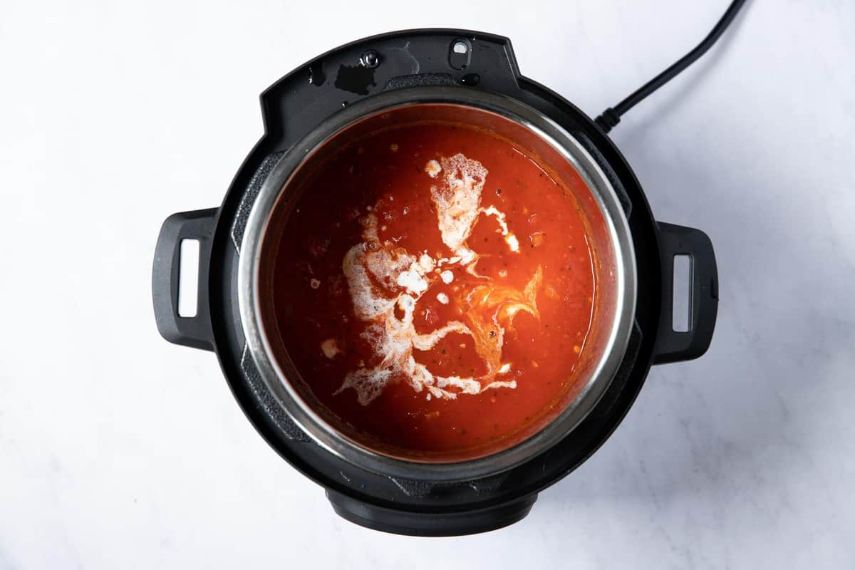 tomato soup with splashes of heavy cream swirled in.